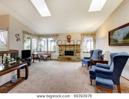 Living Room With Antique Furniture And Skylight