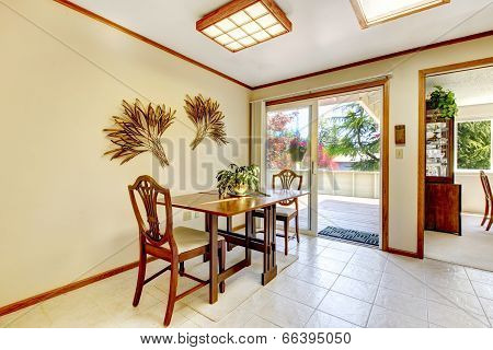 Bright Dining Area With Walkout Deck