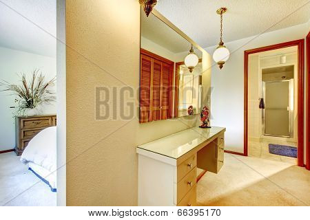 Bedroom With Vanity And Mirror