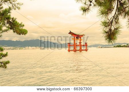 Great floating gate (O-Torii) on Miyajima island near Itsukushima shinto shrine, Japan in a warm tint