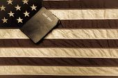 picture of holy-bible  - King James Bible with vintage American flag as the backdrop - JPG