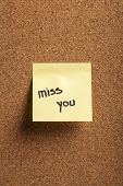 picture of miss you  - Color shot of a cork board with a sticky note reading  - JPG