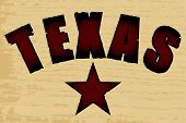 stock photo of texas star  - The word Texas branded on a wooden background with a wood grain effect - JPG