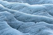 stock photo of crevasse  - Crevasses and blue ice in the Skaftafells glacier Iceland - JPG
