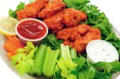 image of chicken wings  - Spicy buffalo chicken wings served with hot and sour dip and crispy veggies - JPG