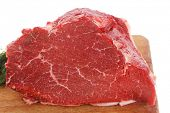 stock photo of red meat  - fresh raw red beef meat big steak chunk on wooden cut board isolated over white background - JPG
