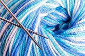 stock photo of alpaca  - Varicolored balloon of yarn with metal knitting needles - JPG