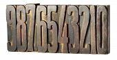 pic of descending  - Set of old metal printers blocks for setting type with numbers 0 through 9 arranged in descending order left to right isolated on white - JPG
