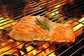 stock photo of red meat  - Grilled salmon on the flaming grill - JPG