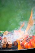 pic of barbie  - Delicious grilled meat skewers on fire - JPG