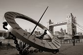 foto of sundial  - Tower Bridge and sundial over Thames River in London - JPG