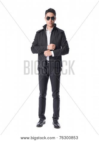 Full body Stylish bodyguard with glasses and folded arms. Isolated over white background