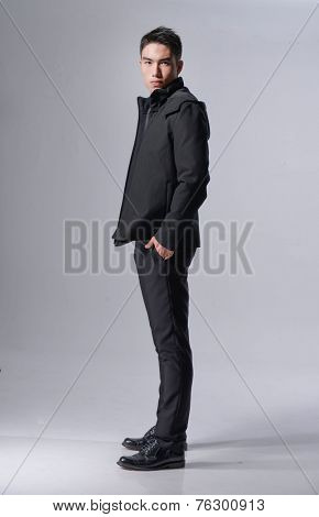 Fashion full length Young asian man looking confident in business attire