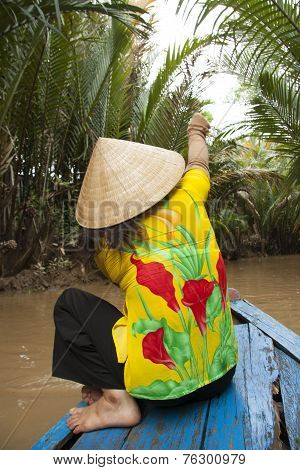 Vietnam woman in boat in jungle