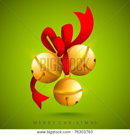 Elegant Christmas bells tied with red ribbon on green background for Merry Christmas festival celebrations.