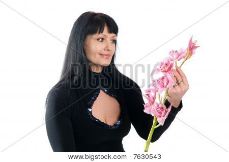 Beautiful Woman Of 45 Years And An Orchid