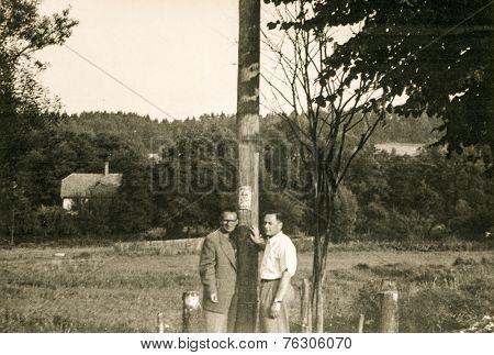 POLAND, CIRCA FIFTIES: Vintage photo of two men outdoor