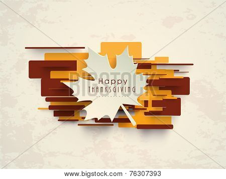 Beautiful white paper maple leaf on colourful yellow and brown background on beige background for Happy Thanksgiving Day celebrations.
