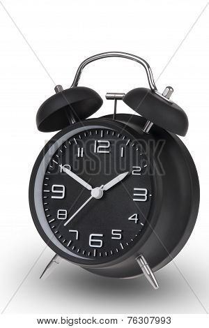 Black Alarm Clock With The Hands At 10 And 2