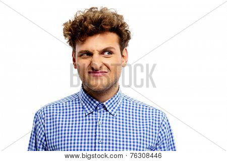 Young man with displeased facial expression