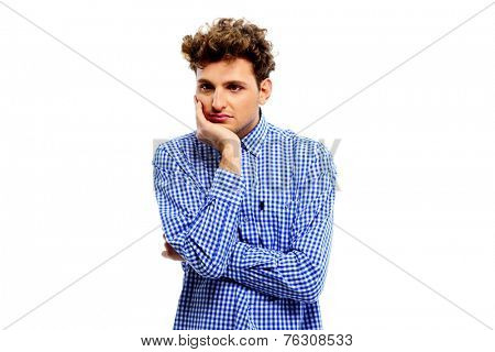 Portrait of a pensive man over white background