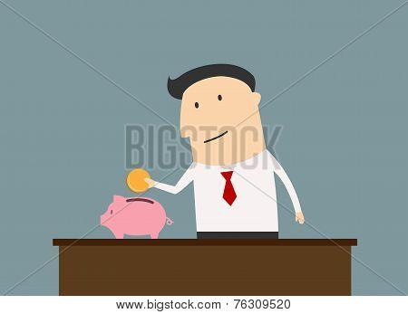 Businessman saving money in piggy bank