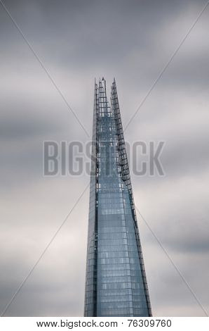 LONDON - 09 JUNE 2013: The Shard - Well Known Tallest Architectural Pyramid in United Kingdom. Captured on Stormy Sky Background on 09 June 2013.
