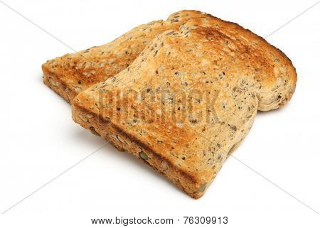 Toasted wholewheat seeded bread on white background.