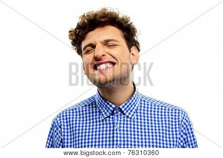 Man showing his teeth over white background
