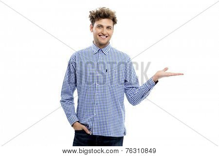 Happy casual man holding invisible product over white background