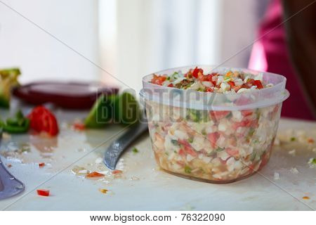 Close up of Bahamian woman making traditional conch salad