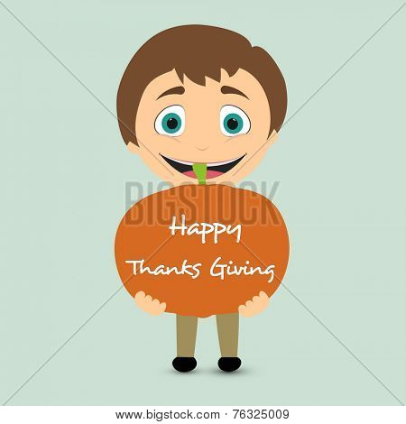 Cute little happy boy holding a big pumpkin on green background for Happy Thanksgiving Day celebrations.