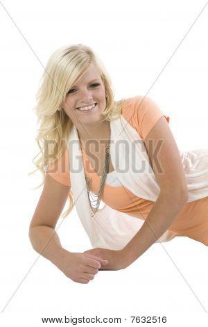 Girl In Orange Laying Close Up