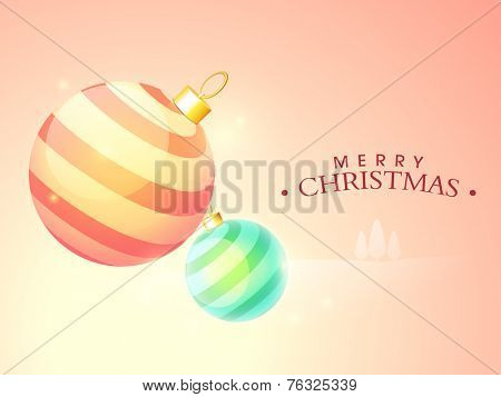 Colorful X-mas Balls on shiny background for Merry Christmas celebration celebrations.