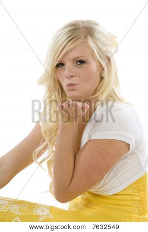 Girl In Yellow Dress Blowing Kiss Up Close