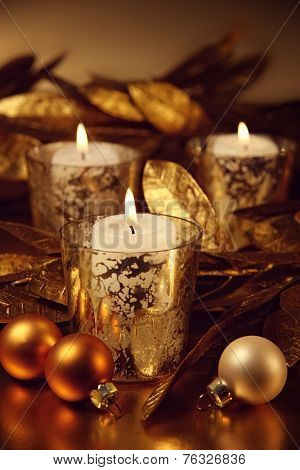 Closeup of candles lit with a sparkling gold theme