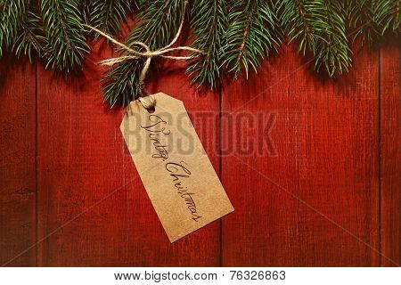 Gift tag on vintage red wood background