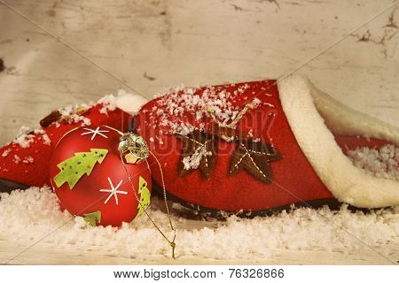 Christmas slippers with ornament and snow