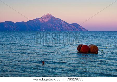 Greek coast of aegean sea at sunset near holy mountain Athos
