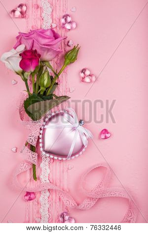 Valentine's day card  with flowers and hearts on pink background