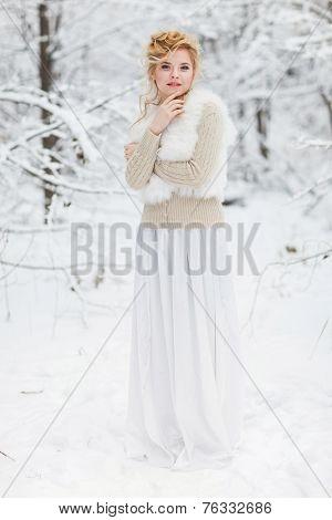 Portrait of beautiful woman in snowy forest