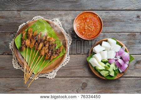 Hot and spicy Asian dish. Chicken sate or satay, skewered and grilled meat, served with peanut sauce. Fresh cooked with steamed and smoke.