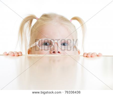 Frightened kid or child in eyeglasses playing isolated on white