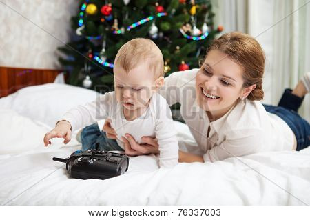 Young mother and son playing with RC controller