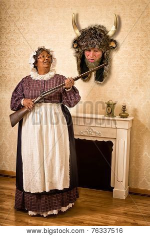Funny Victorian wife holding a gun in front of her dead husband as a hunting trophy