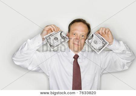 Businessman Tearing Money