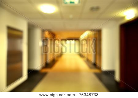 A corridor of a commercial building in perspective. A blurred, bokeh background effect.