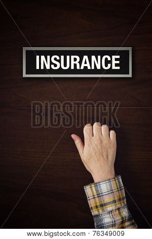 Hand Is Knocking On Insurance Door