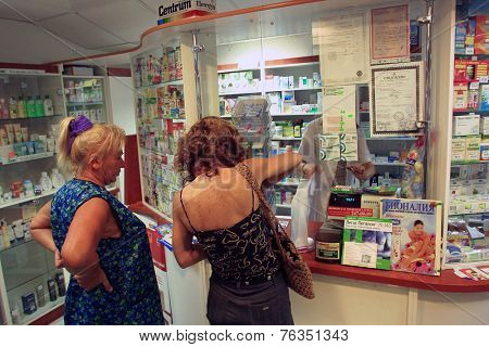 KIEV, UKRAINE - 16 AUGUST 2003: People wiat on line at a privately owned  pharmacy in Kiev, Ukraine.