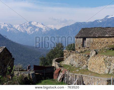 Cyclist in a Corsica village